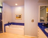 25-opalseas_main-level-poolside-king-master-bedroom-two-ensuite-bath_sm