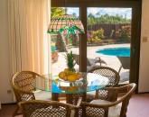 9-ocean-pool-hale_dining-table-pool-view_600x800