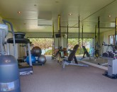 20-paul_mitchell_estate-19-gym-with-glass-sliding-doors-and-full-ocean-view-800x534